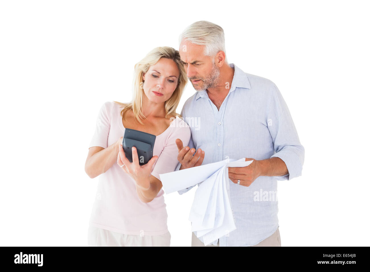 Anxious couple working out their bills - Stock Image
