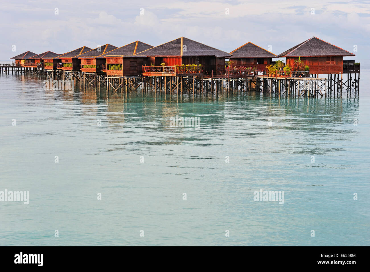 Bungalow vacation resort on lagoon, Island of Borneo, Sabah State, Malaysia, Southeast Asia - Stock Image
