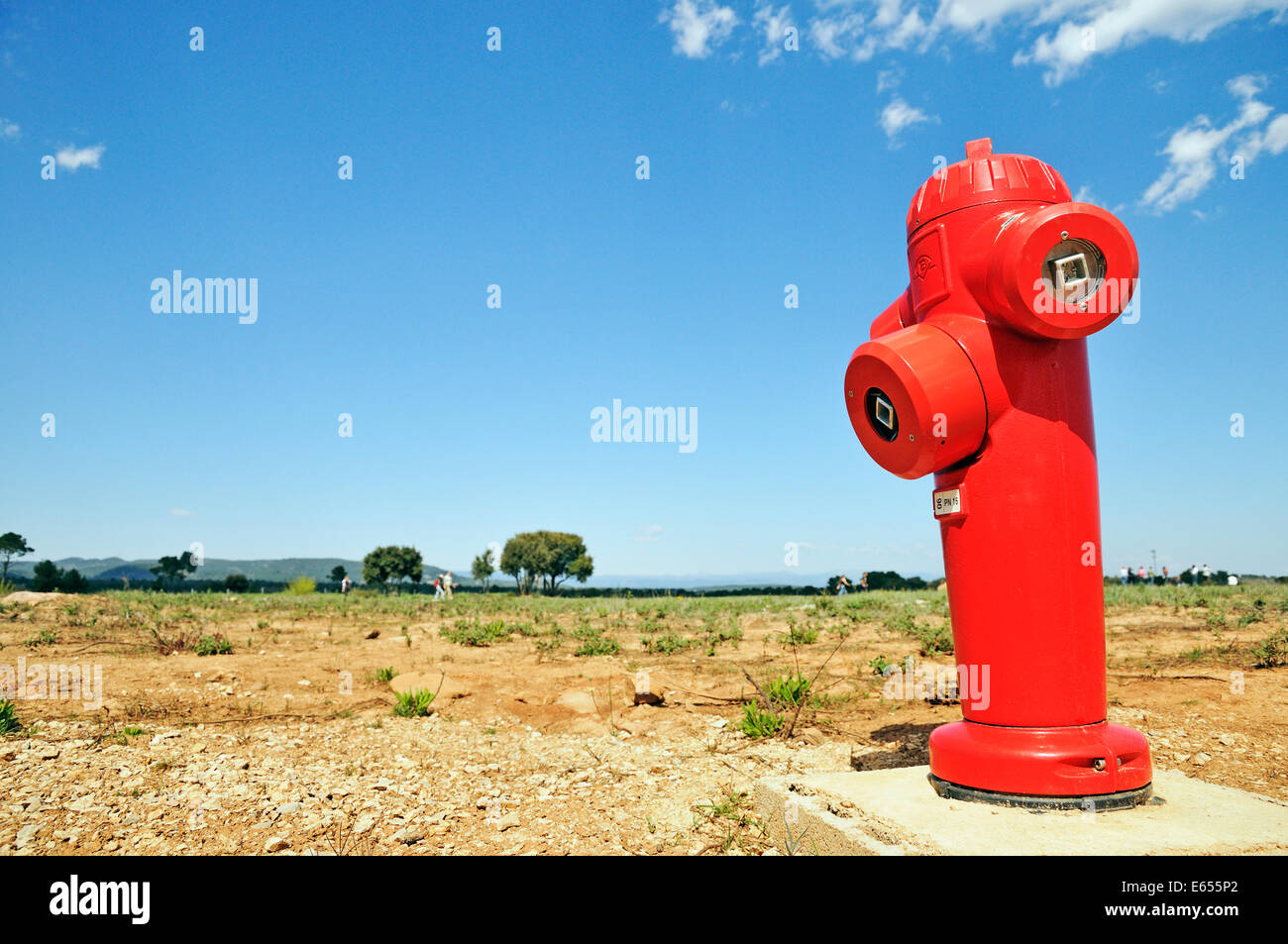Red fire hydrant in remote countryside, Var, France, Europe - Stock Image