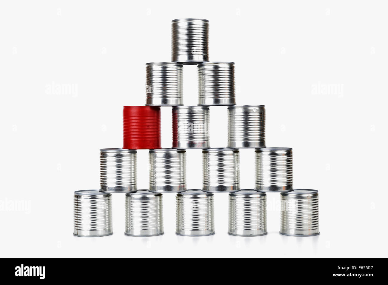 Red tin can inside a pyramid - difference concept - on white background - Stock Image
