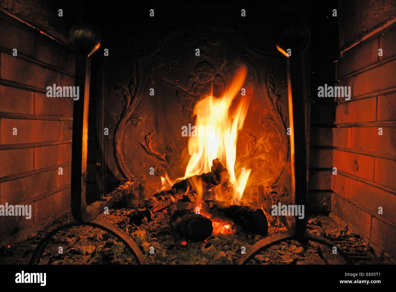 Log fire burning in a fireplace - Stock Image