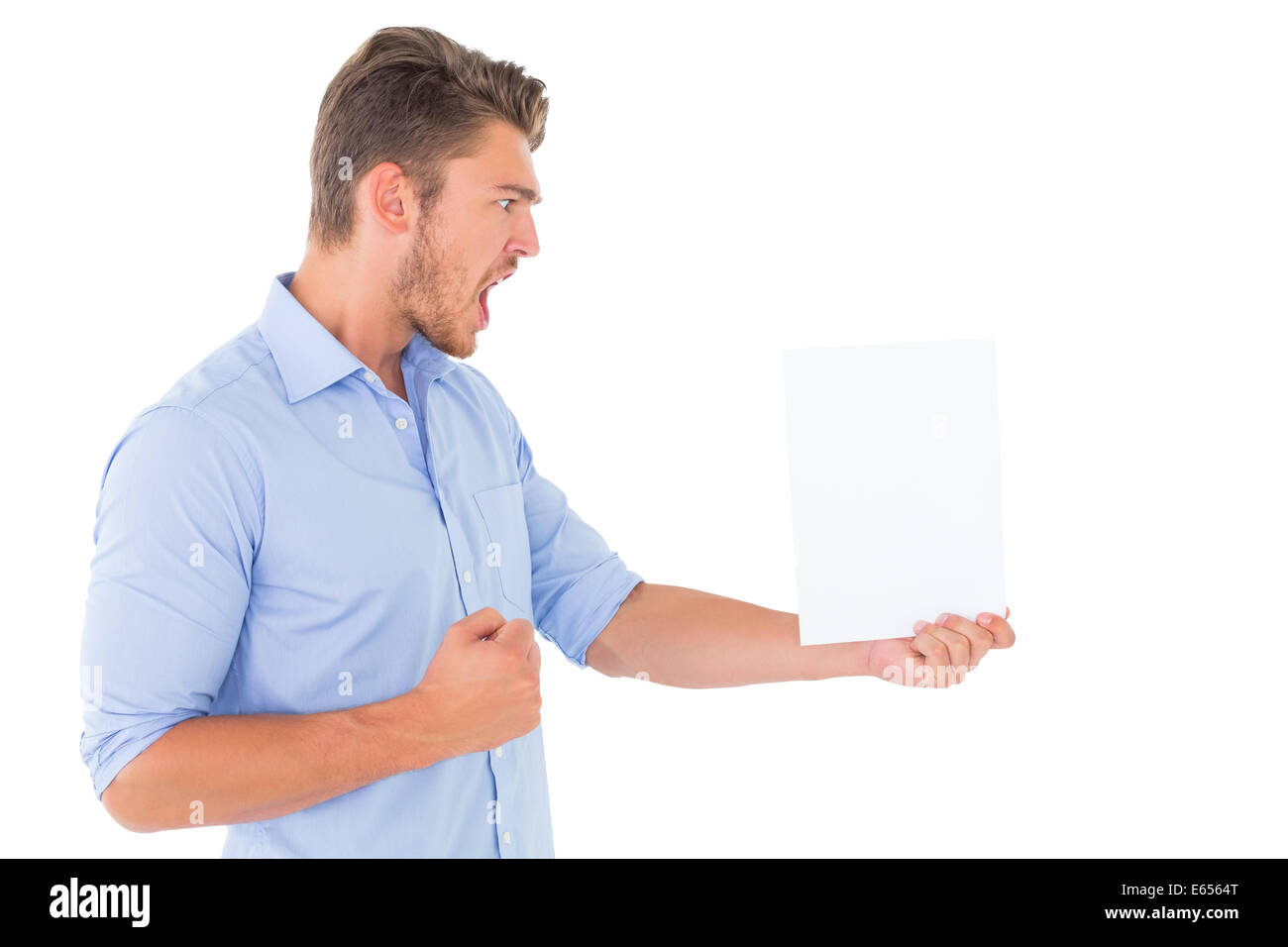Angry man looking at page - Stock Image