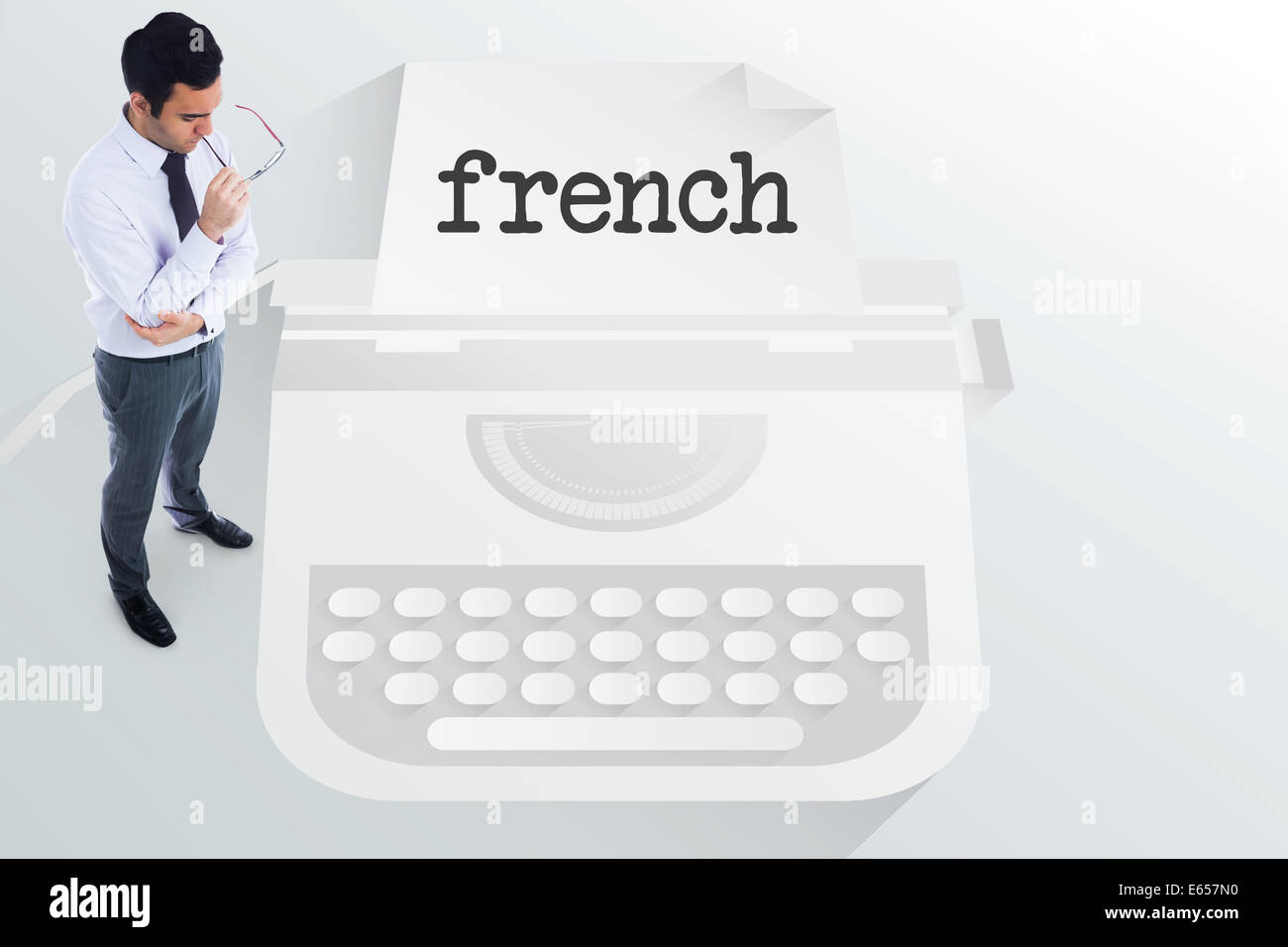 The word french and unsmiling businessman holding glasses - Stock Image