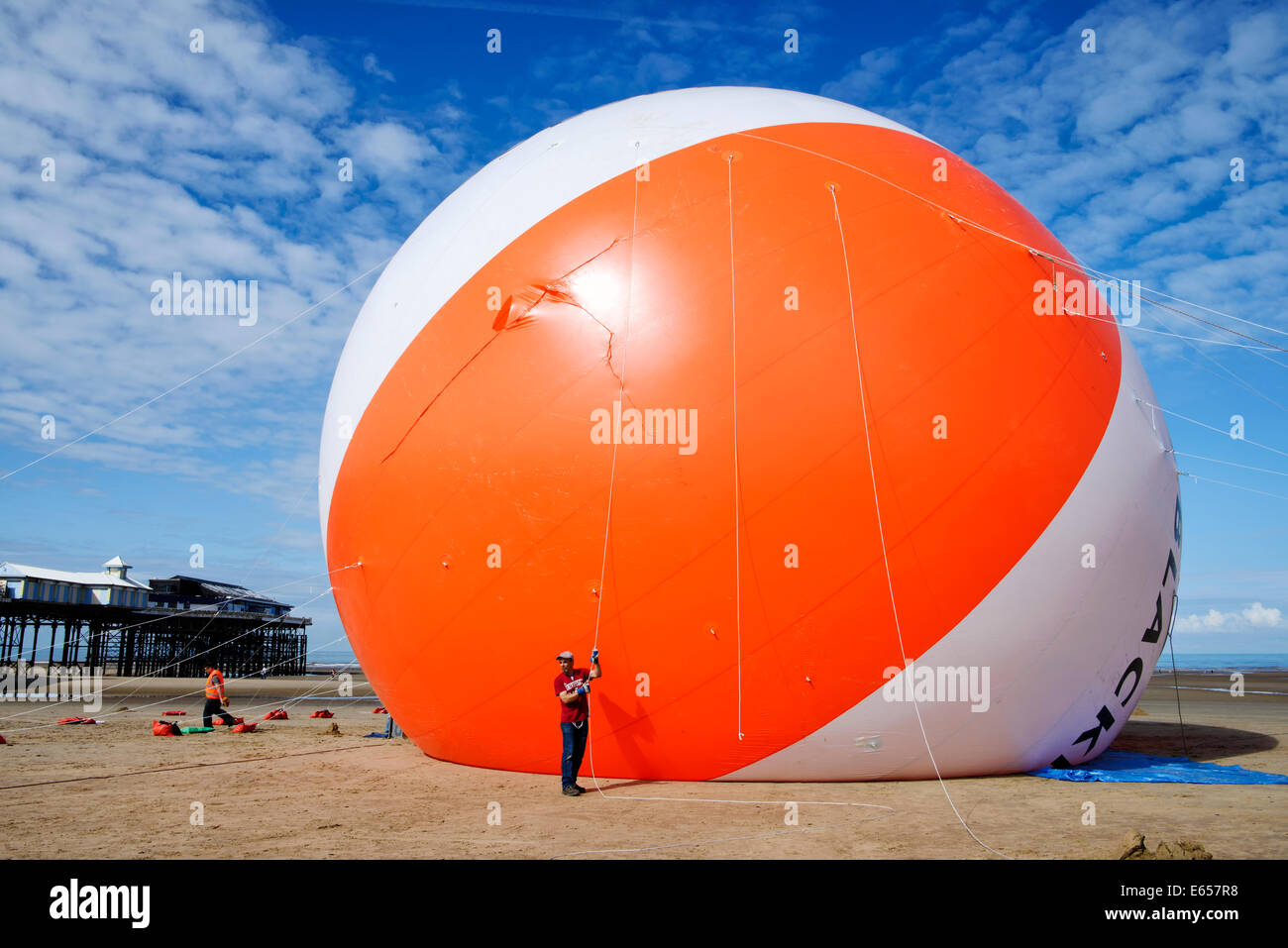 Blackpool now holds the Guinness World Record for the biggest beach ball in history. The seaside resort had it's - Stock Image