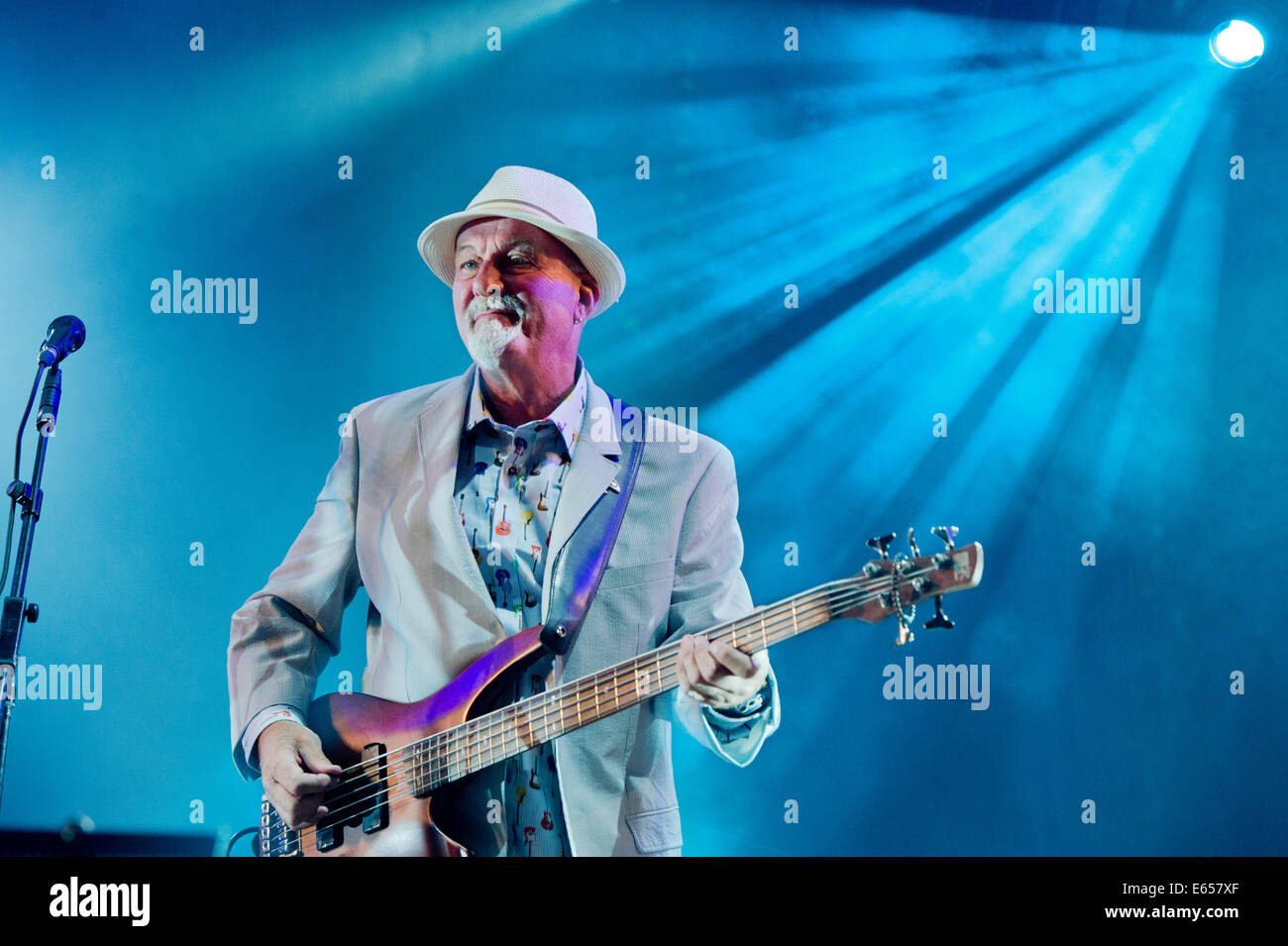 Dave Pegg of Fairport Convention, on the Bass guitar at Cropredy Festival 2014. - Stock Image