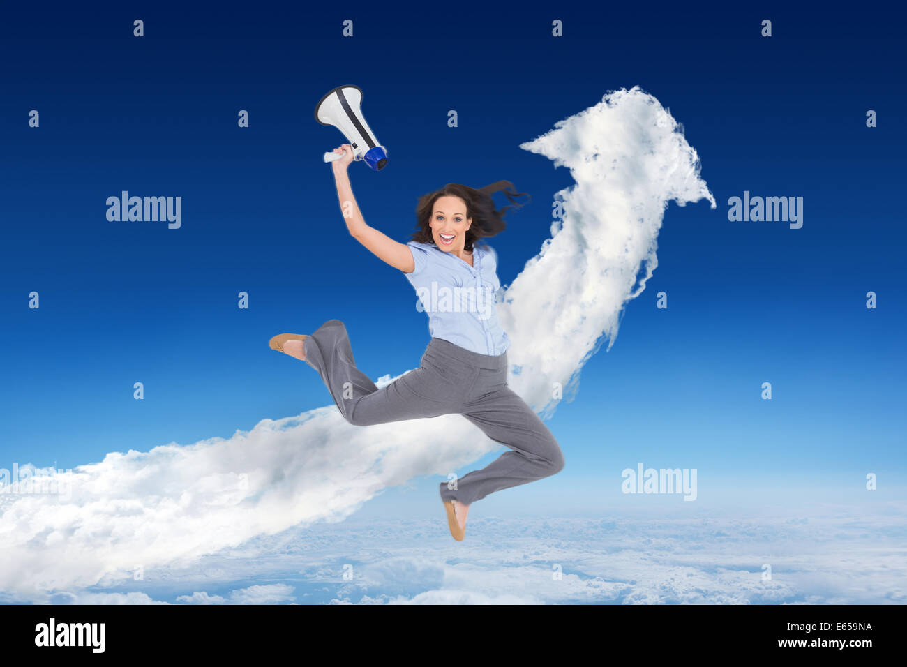 Composite image of cheerful classy businesswoman jumping while holding megaphone - Stock Image