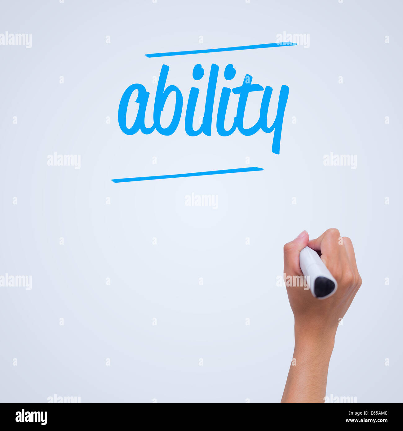 Ability against female hand writing with marker - Stock Image