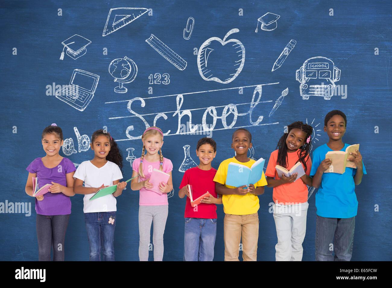 Composite image of elementary pupils reading books - Stock Image