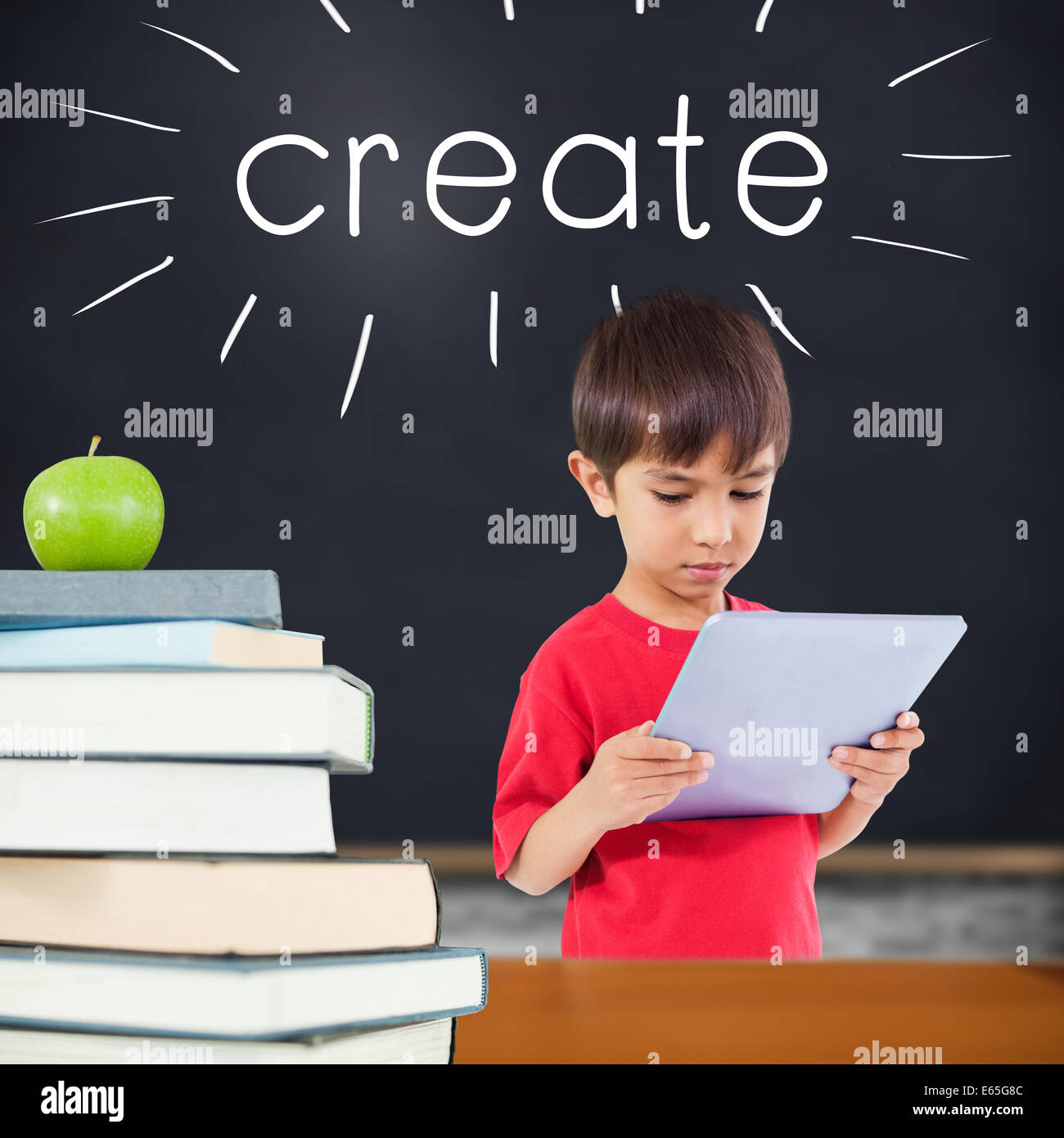 Create against green apple on pile of books in classroom - Stock Image