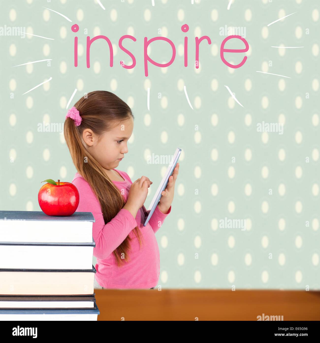 Inspire against red apple on pile of books - Stock Image