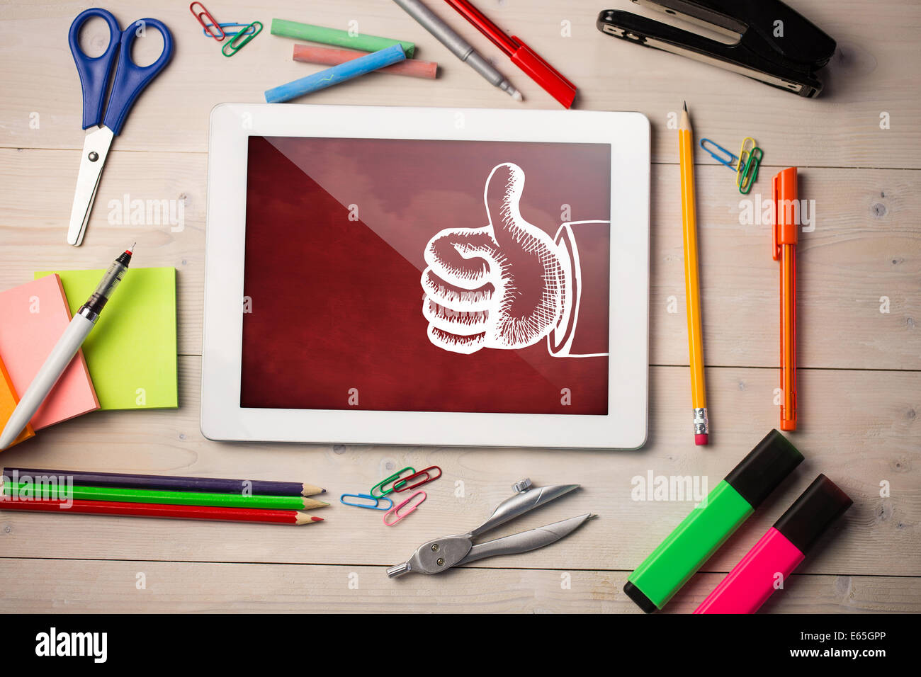 Composite image of digital tablet on students desk Stock Photo