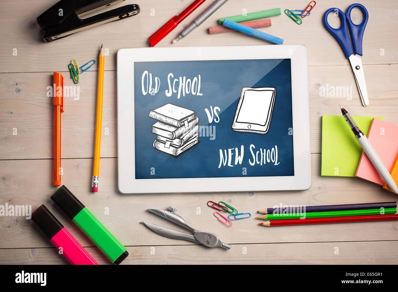 Composite image of digital tablet on students desk Stock Photo
