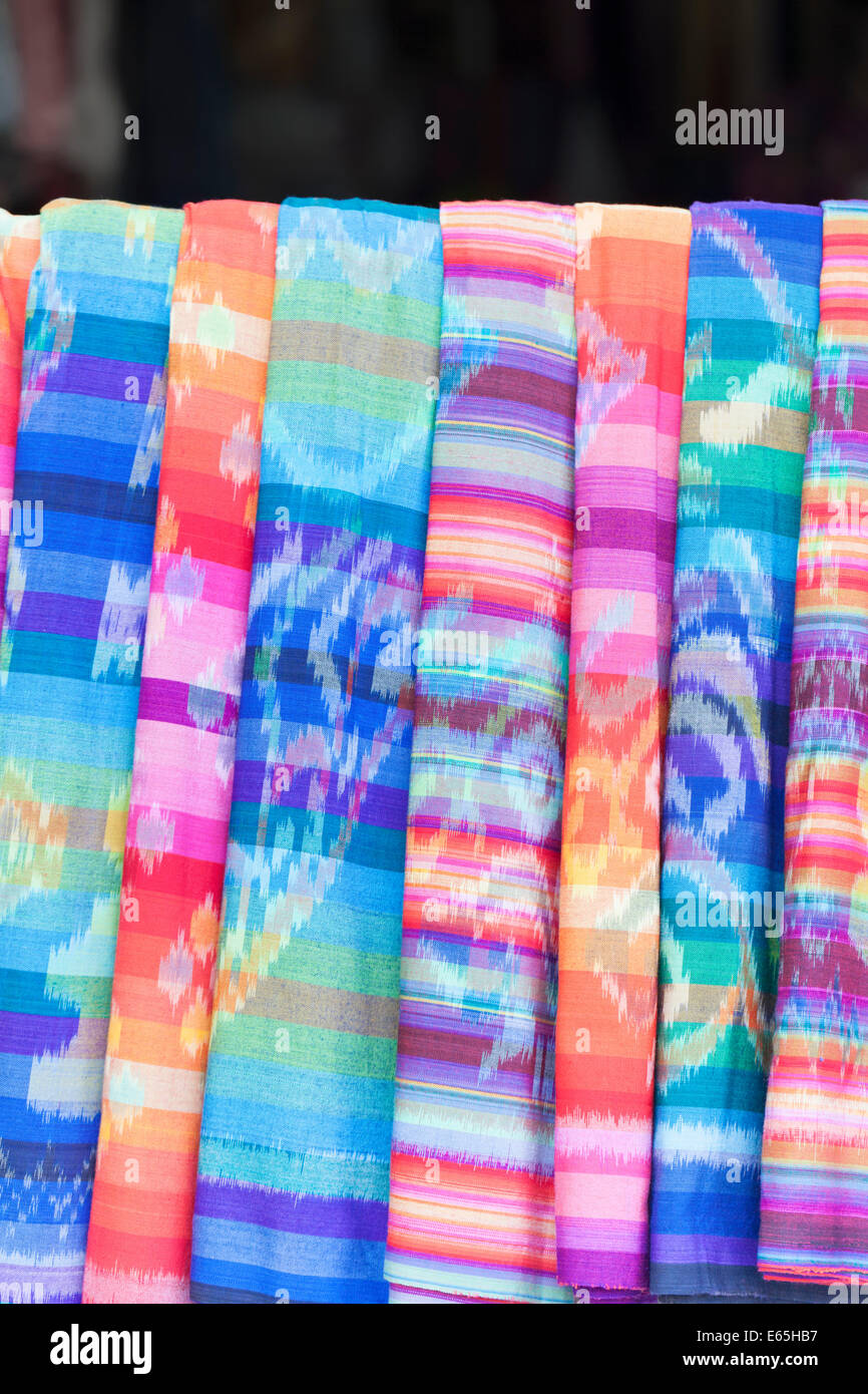 Colourful textiles on display at a shop in Bali, Indonesia - Stock Image