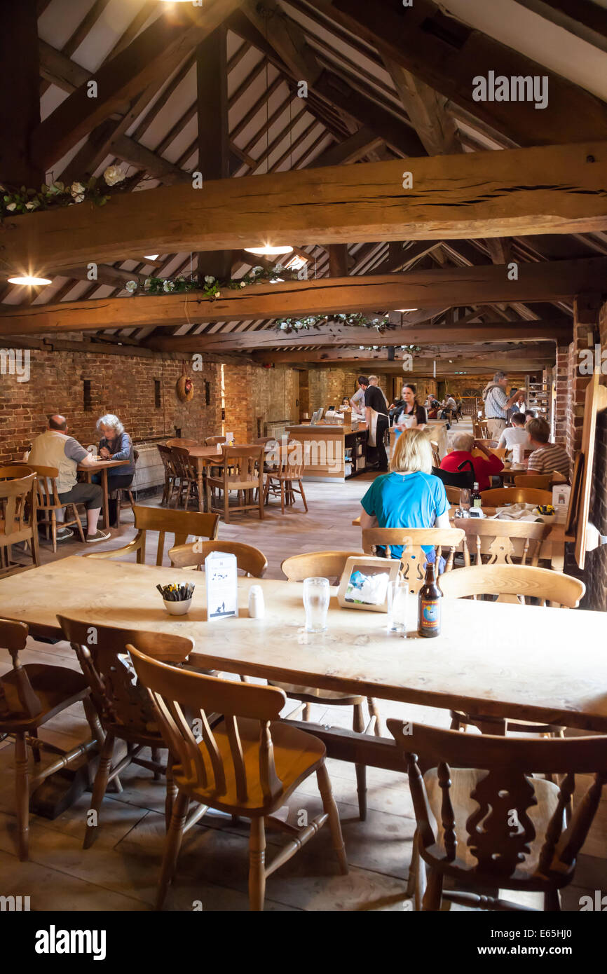 People eating and drinking in the cafe at Dunham Massey Hall Altrincham Greater Manchester Cheshire - Stock Image