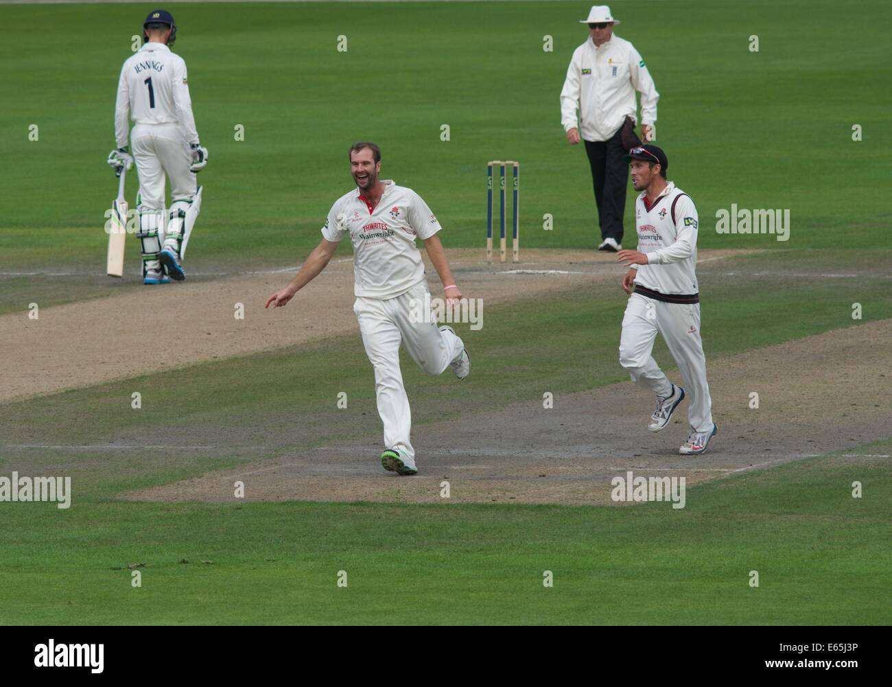 Emirates Old Trafford, Manchester, UK. 15th Aug, 2014. Tom Smith (Lancashire) celebrates taking the first wicket Stock Photo