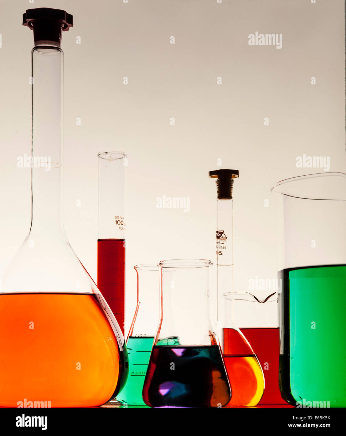 Chemical Flasks and Beakers with coloured fluids Stock Photo