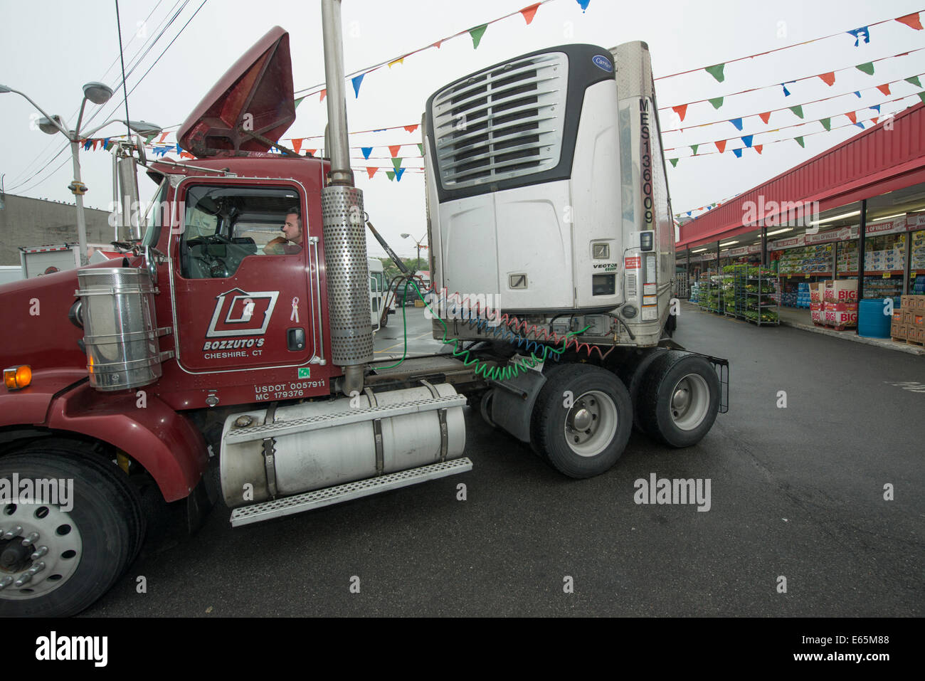Trucking distribution.  Kyle Chapman, driver for Bozzuto's, the largest distributor of food in Connecticut, - Stock Image