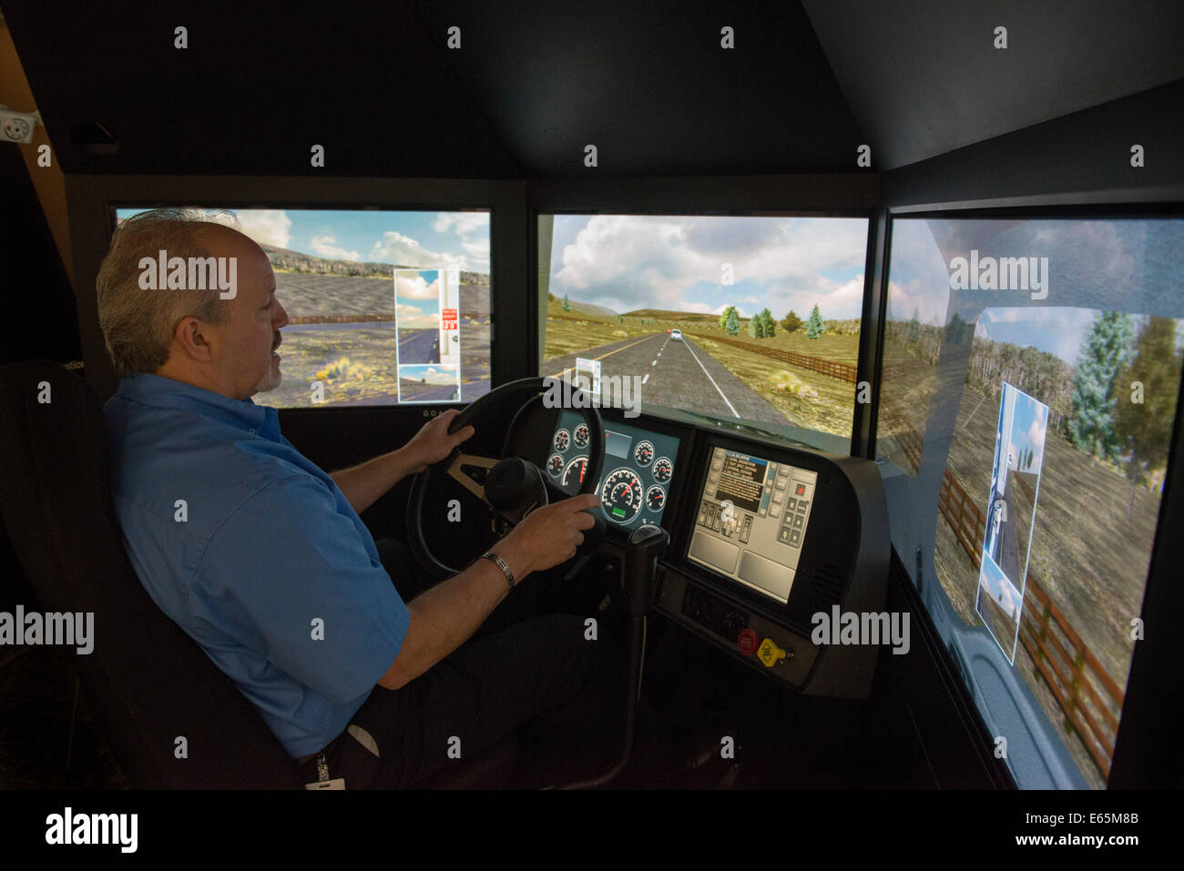 L3 Communications motion based truck driving simulator used to train truck drivers at Bozzuto's, a giant food - Stock Image