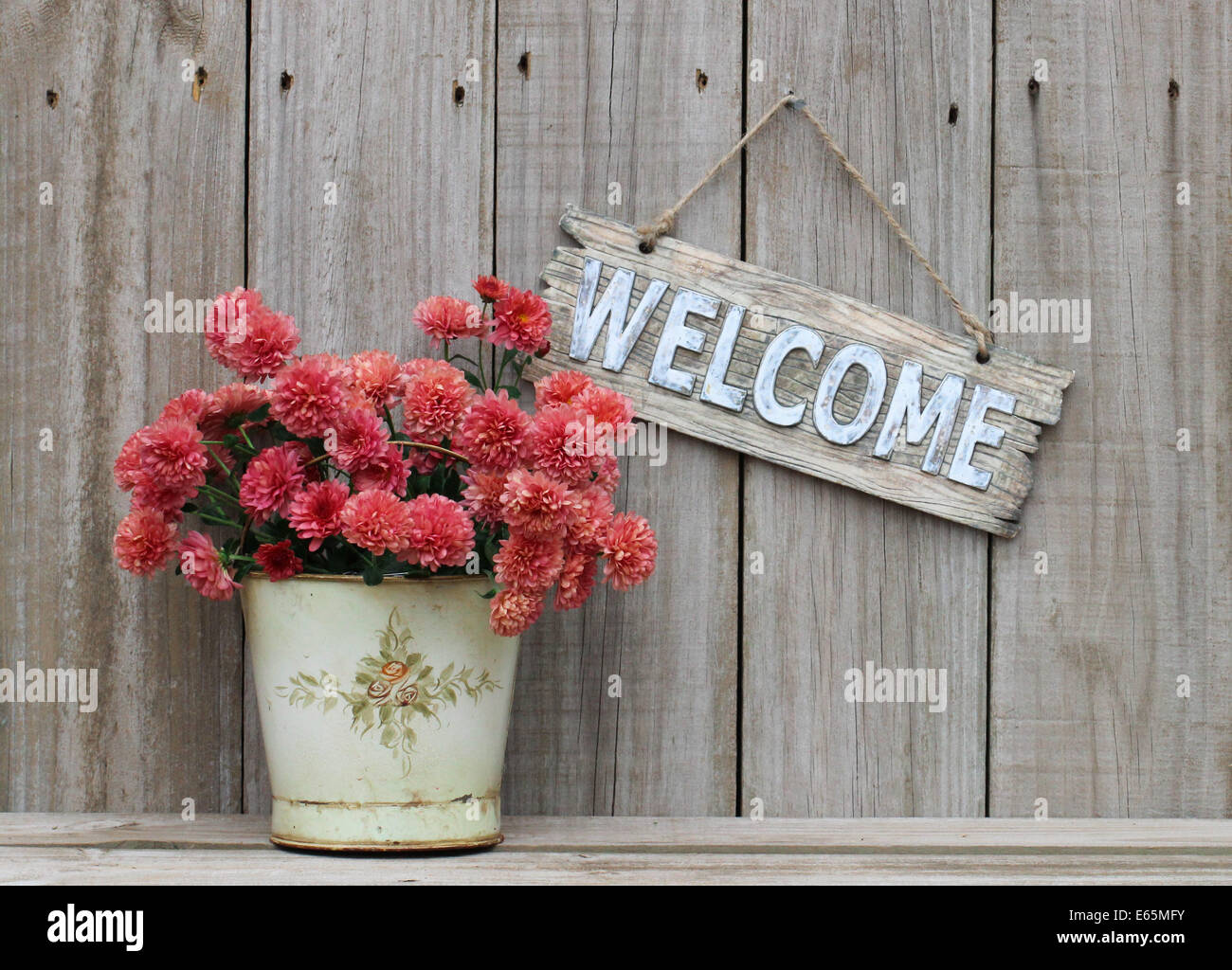 Rustic Welcome Sign Hanging On Weathered Wood Fence Next