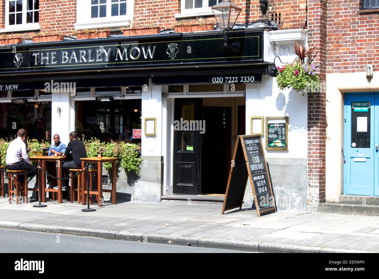 People socialising, during the lunch hour at the The Barley Mow - Stock Image