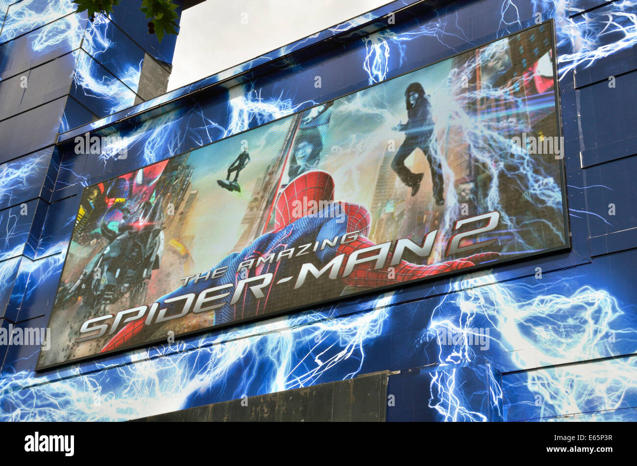 Giant video screen outside the Odeon Leicester Square Cinema promoting the film Spiderman 2 - Stock Image