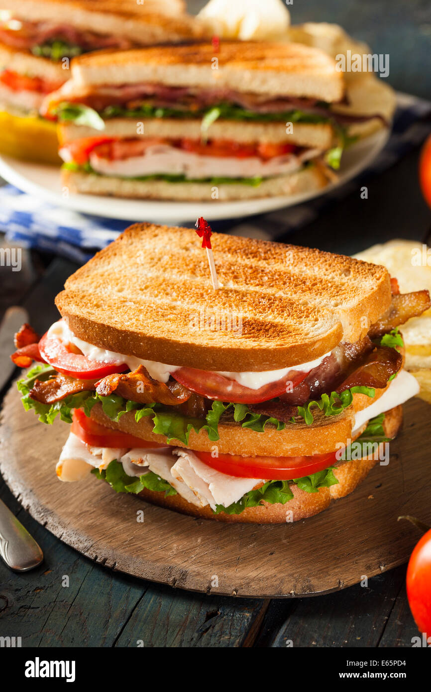 Turkey and Bacon Club Sandwich with Lettuce and Tomato - Stock Image