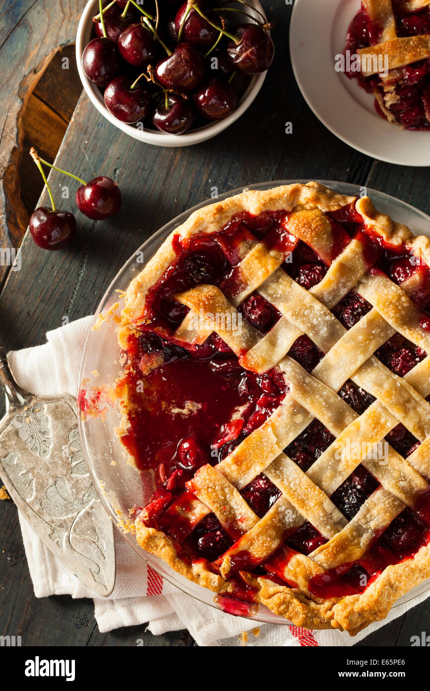Delicious Homemade Cherry Pie with a Flaky Crust - Stock Image