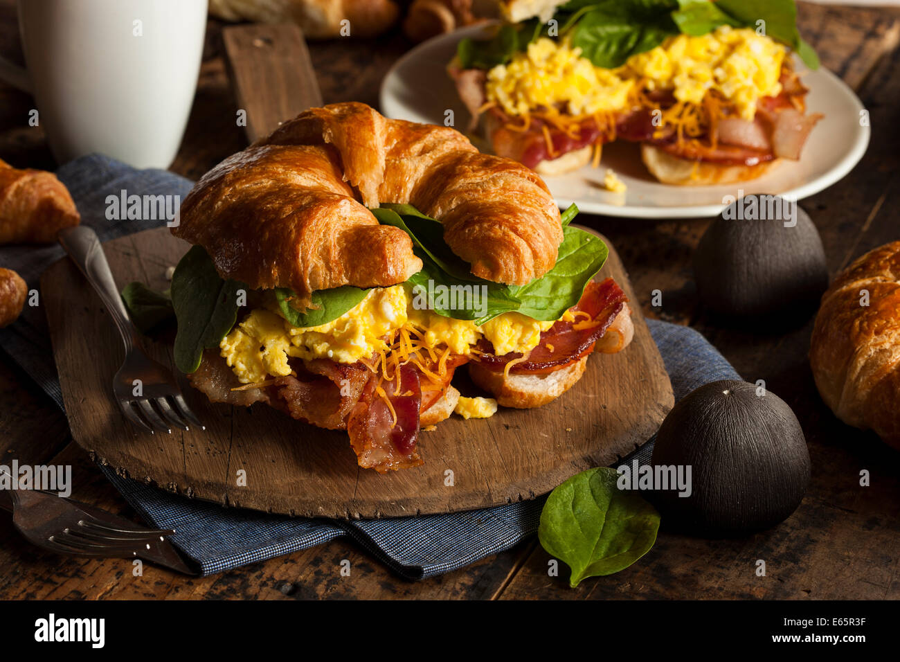 Ham and Cheese Egg Breakfast Sandwich on a Croissant - Stock Image