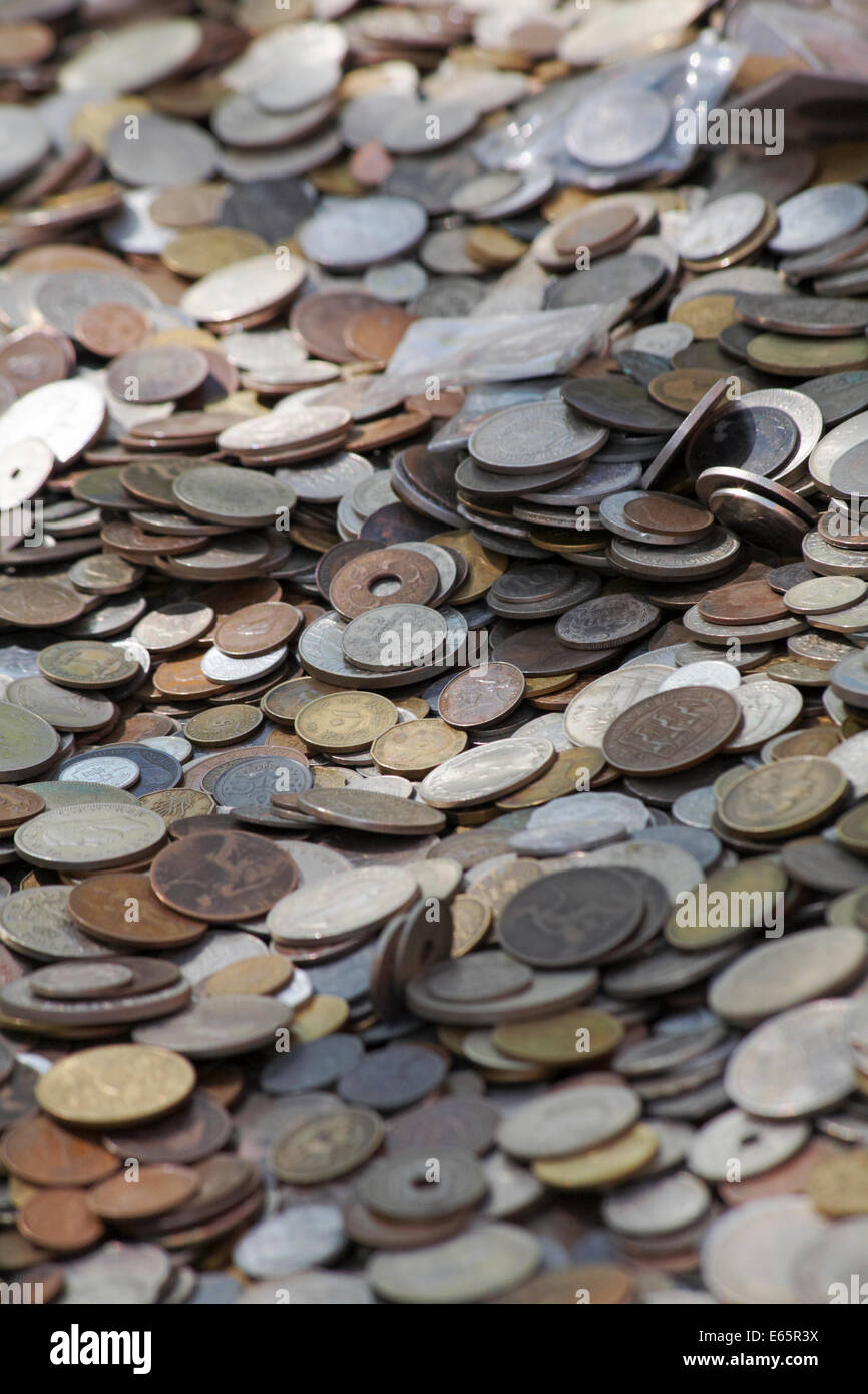 old coins for sale at outdoor market stall at Oxford in May