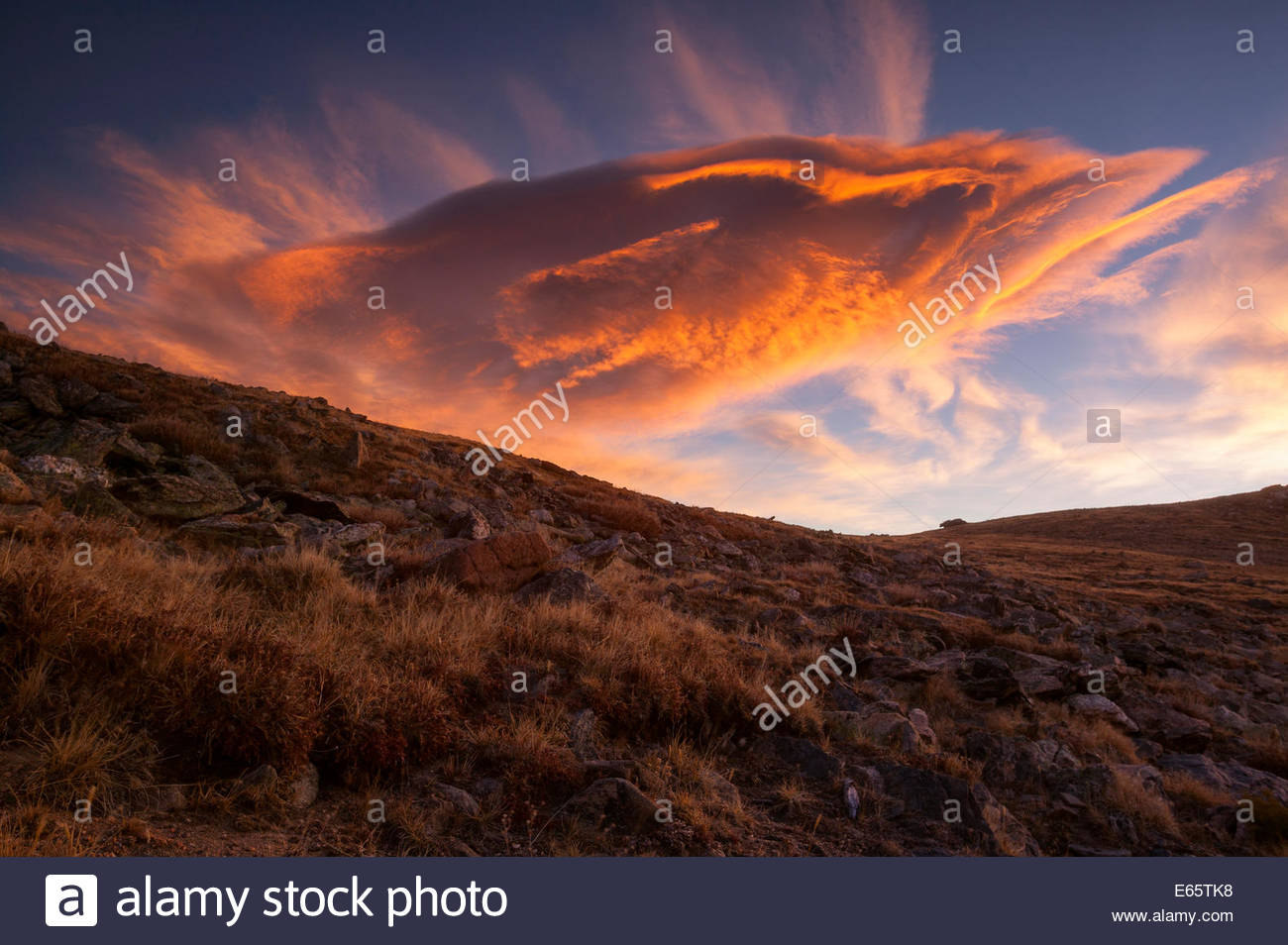 A colorful storm cloud hovers over the alpine tundra at about 12,000-feet elevation in Rocky Mountain National Park, - Stock Image