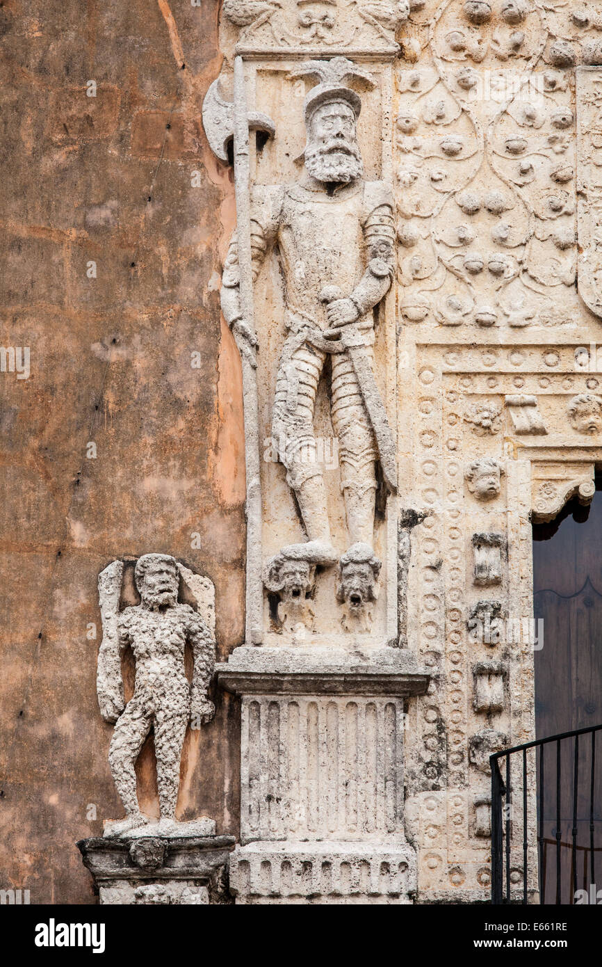 Sculpture depicting the Spanish submission of Mexico's indigenous on the front of the Casa de Montejo in Merida, - Stock Image