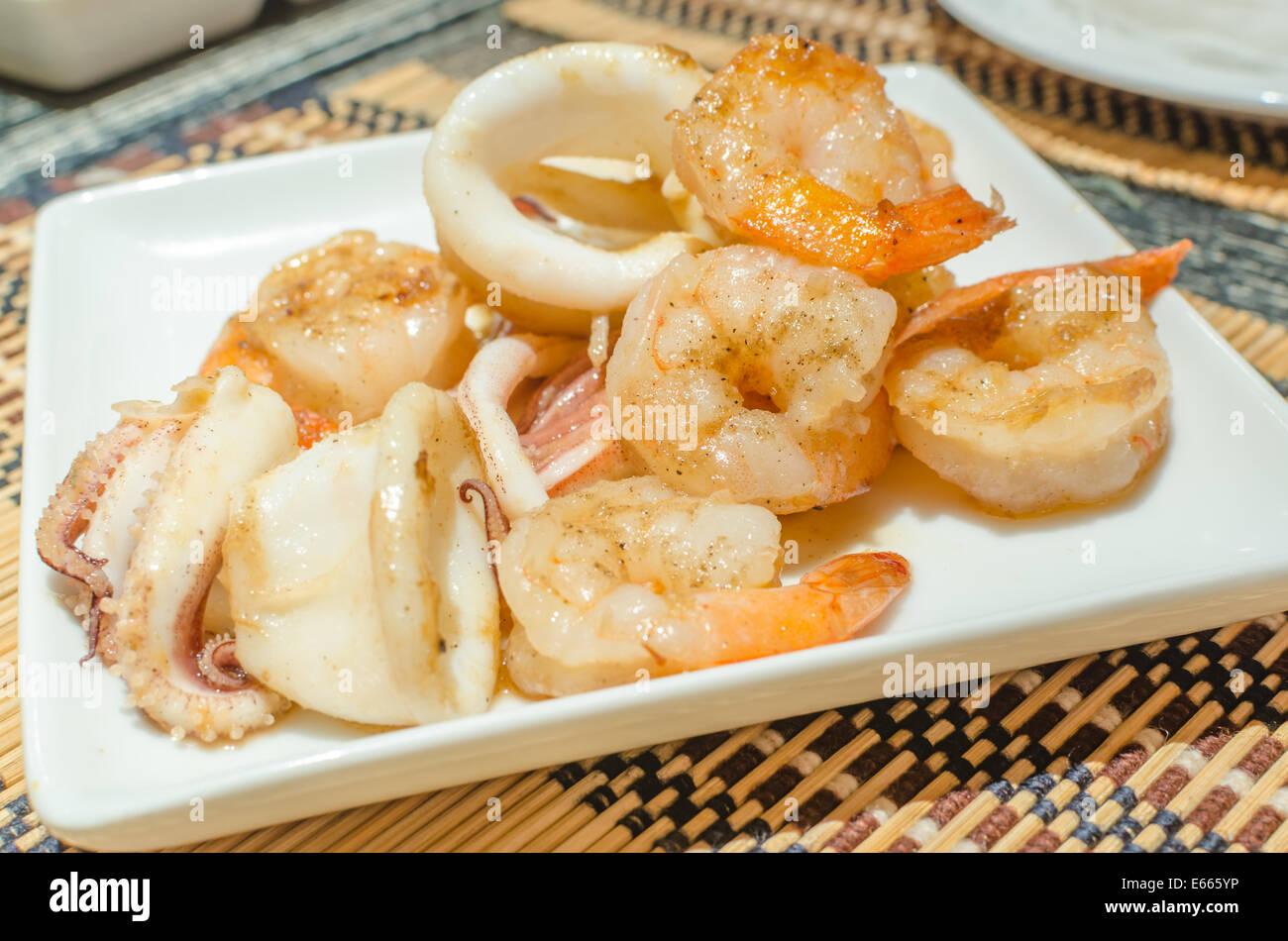 Tiger prawns and squid teppanyaki - Stock Image