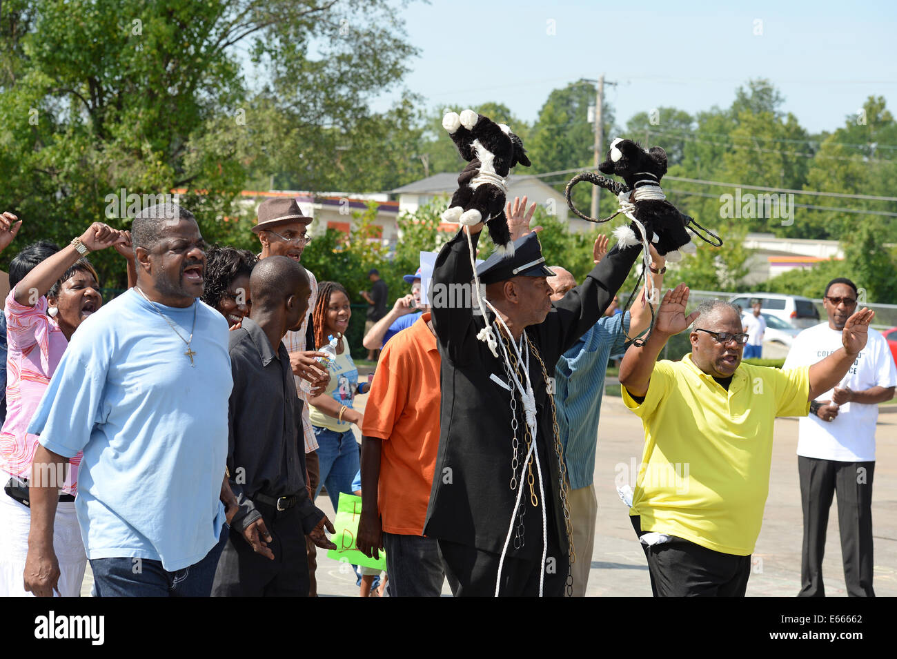 Ferguson, MO, USA. August 15, 2014. Demonstrators at the site of destroyed Quick Trip react after Police Chief Thomas Jackson release of the name of the officer that shot Michael Brown. Stock Photo