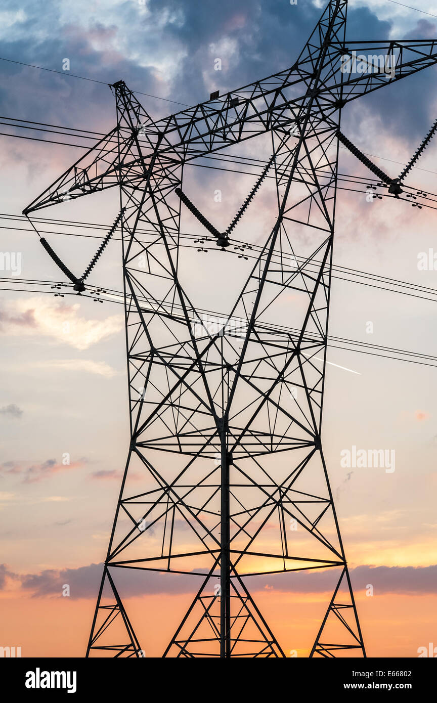 Tower of power  –  silhouetted scaffolding of a high voltage powerline tower at sunset. USA. - Stock Image