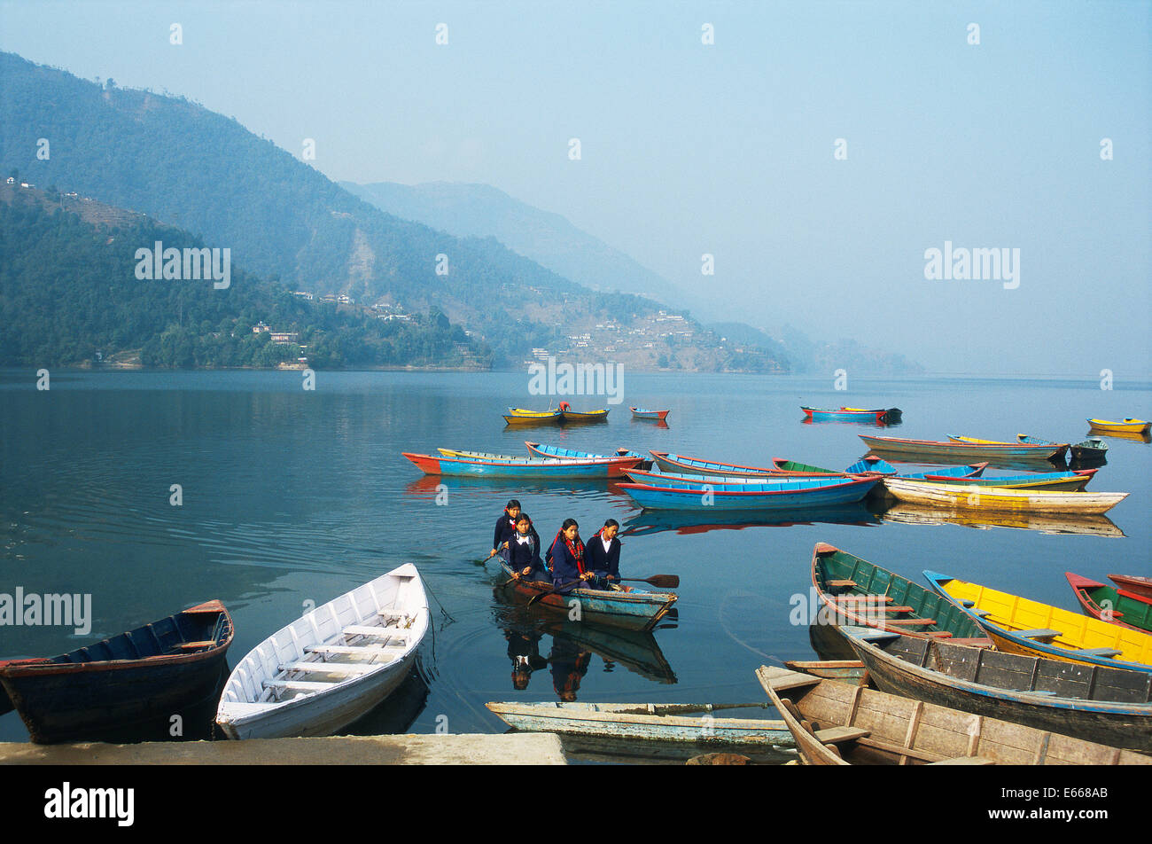 Schoolgirls going to school by boat ( Nepal) - Stock Image