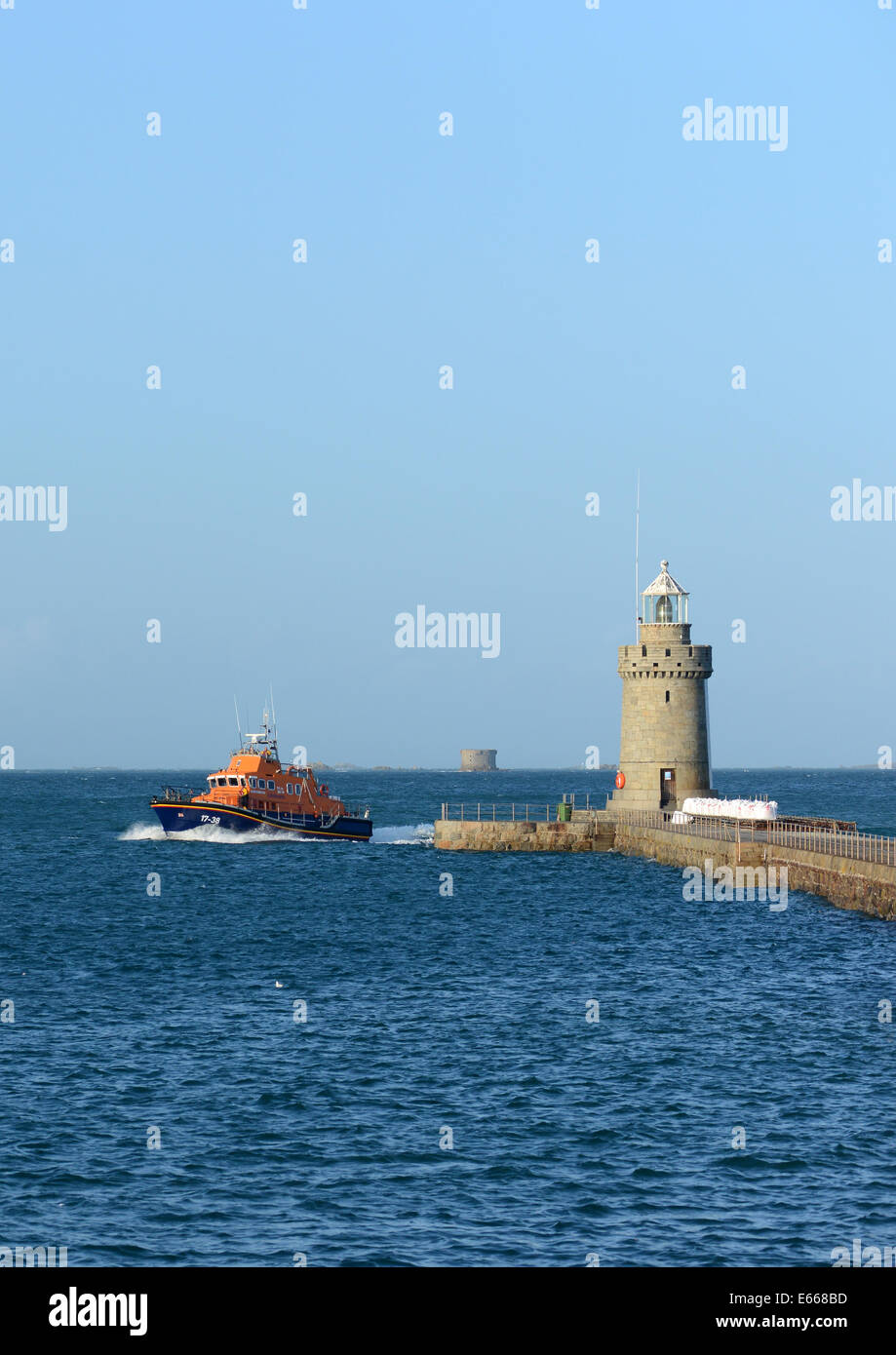 RNLI lifeboat returning St Peter Port, Guernsey, Channel Islands following a distress call - Stock Image