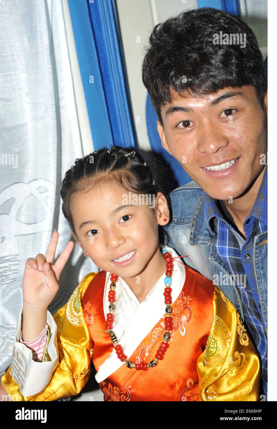 Lhasa, China's Tibet Autonomous Region. 16th Aug, 2014. Nine-year-old Suoyang (L) and her brother pose for photo - Stock Image