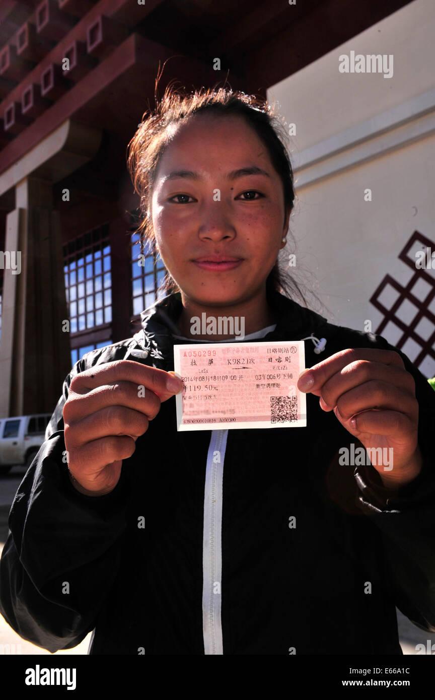 Xigaze, China's Tibet Autonomous Region. 16th Aug, 2014. Ciyang, student of Tibet University, shows her train - Stock Image