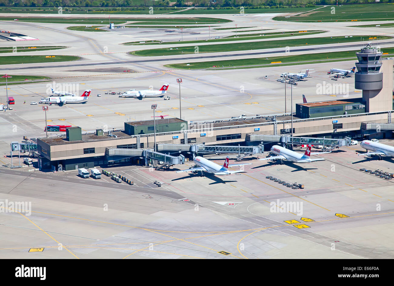 ZURICH - APRIL 17: Aircraft leaving Zurich airport on April 17, 2014 in Zurich, Switzerland. Zurich airport is home - Stock Image