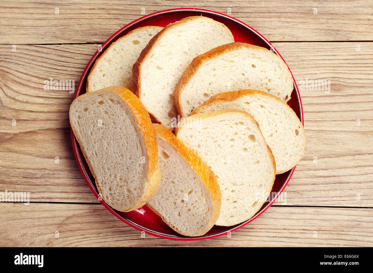 Plate With Slices White Bread On Vintage Wooden Table. Top View