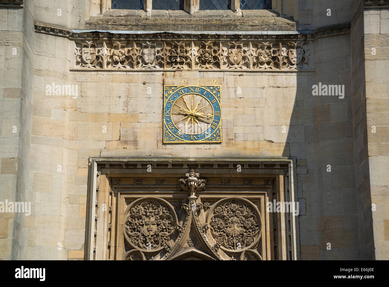 Great St Mary's Church, Clock above the entrance, Cambridge, England, UK - Stock Image