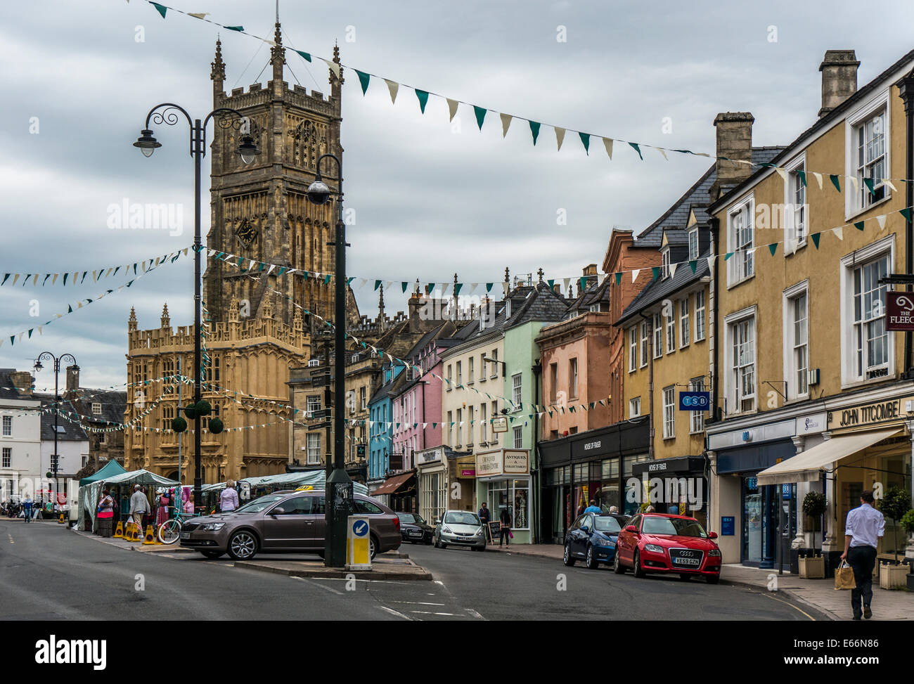 Town centre view, with church, period buildings, independent local shops and market stalls, Cirencester, Cotswolds, - Stock Image