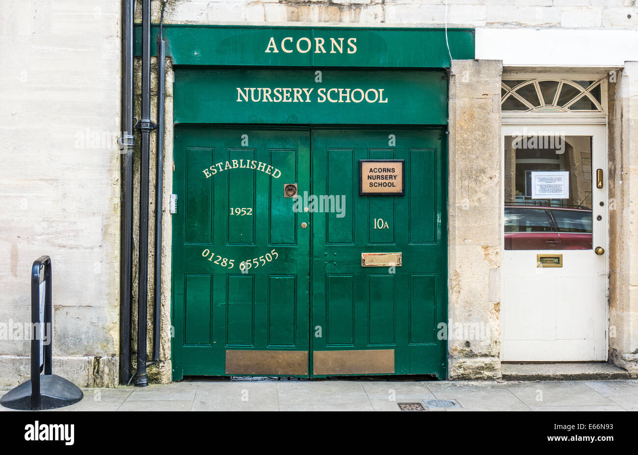 Double green doors - the entrance to Acorns Nursery School (established 1952), Cirencester town centre, Cotswolds, - Stock Image