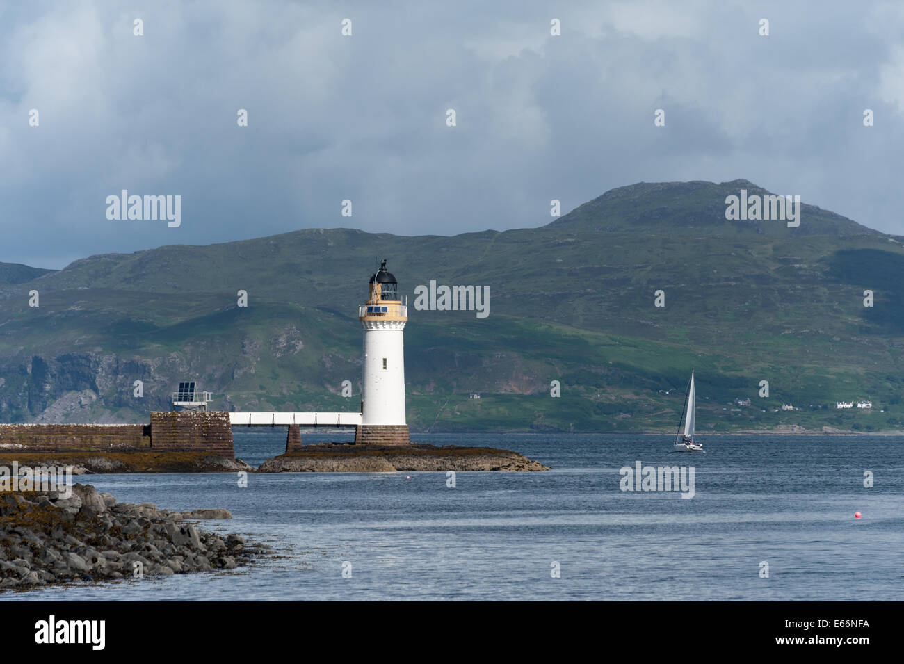 A view of Tobermory Lighthouse on the Isle of Mull in Scotland with Ardnamurchan in the background. Stock Photo