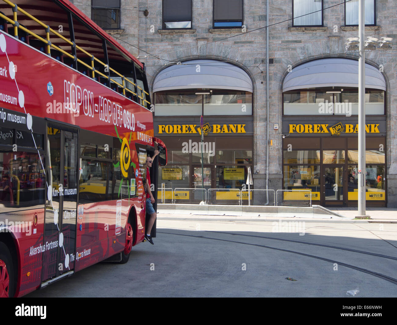 Forex bank and Hop on - Hop off sightseeing bus. Services for tourists in Oslo Norway as well as many other cities - Stock Image