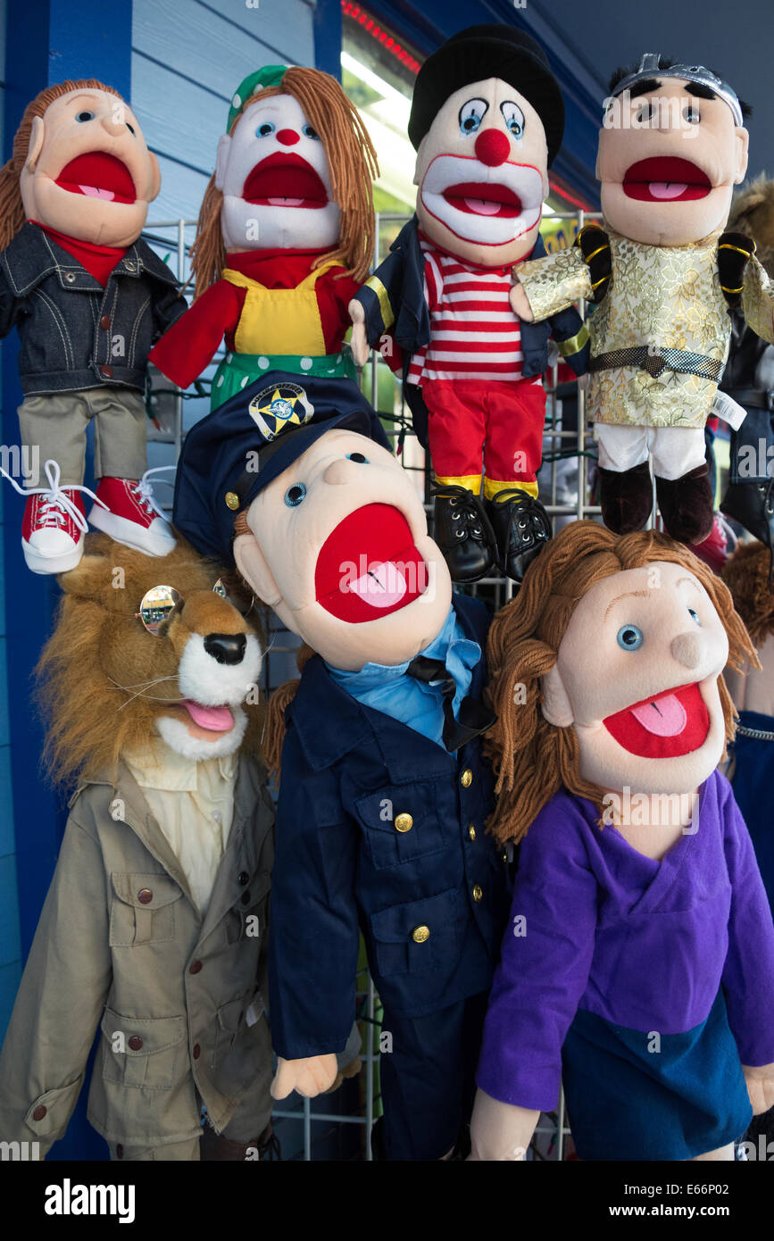 Display of funny colourful puppets outside toy shop. Stock Photo