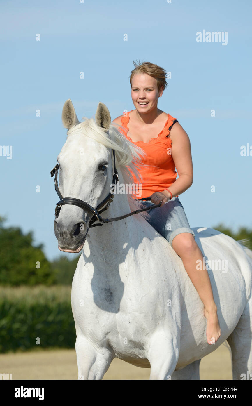 Young woman riding bareback on a 23-year-old Bavarian
