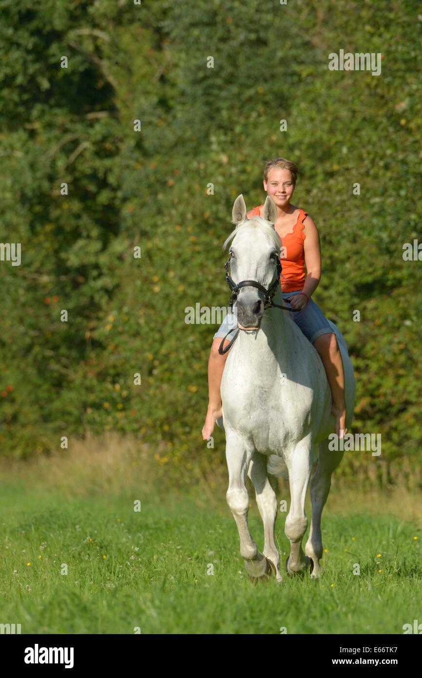 Woman Riding Horse Bareback On High Resolution Stock