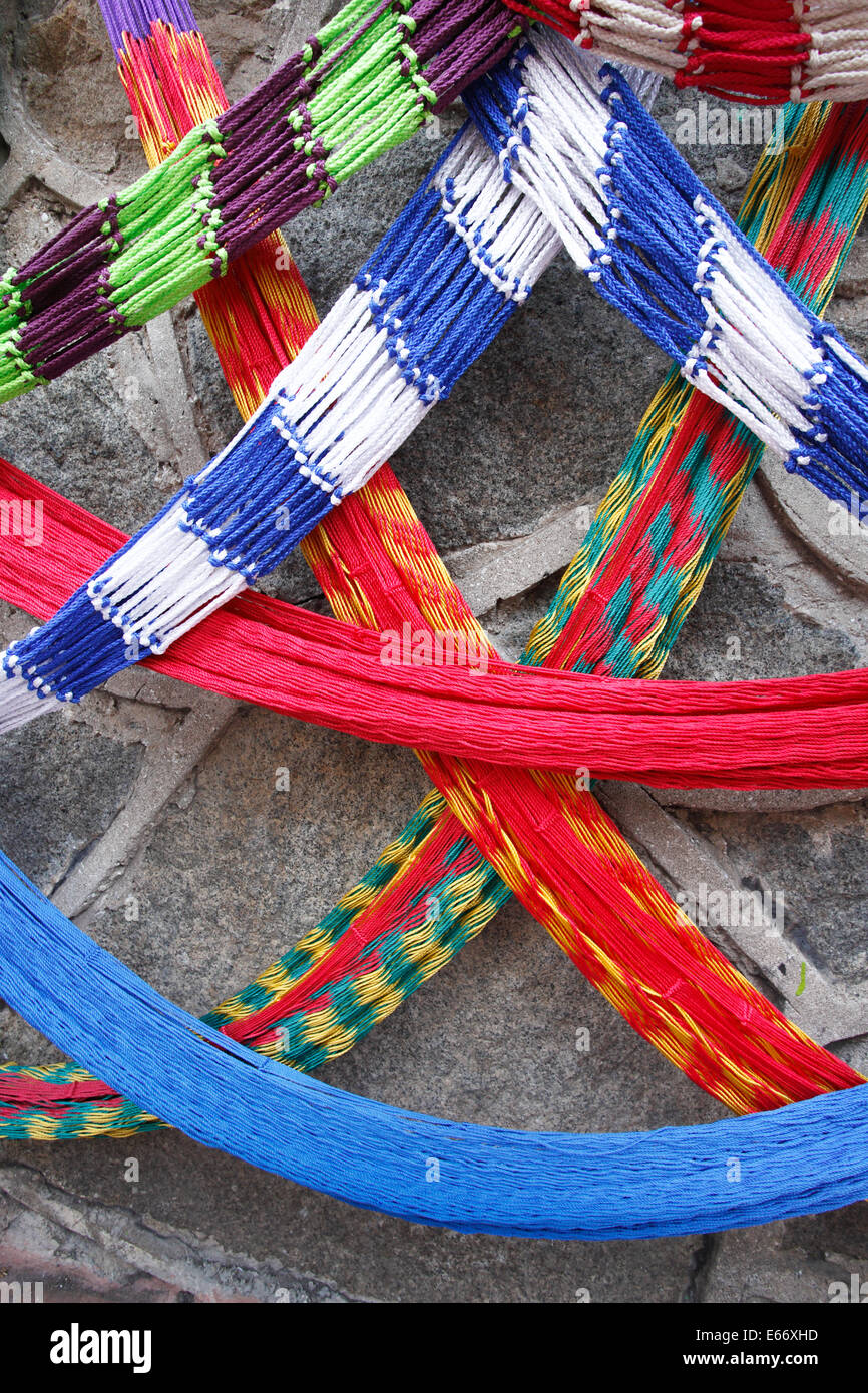 Colorful hammocks hang on a wall in downtown Manzanillo, Colima - Stock Image