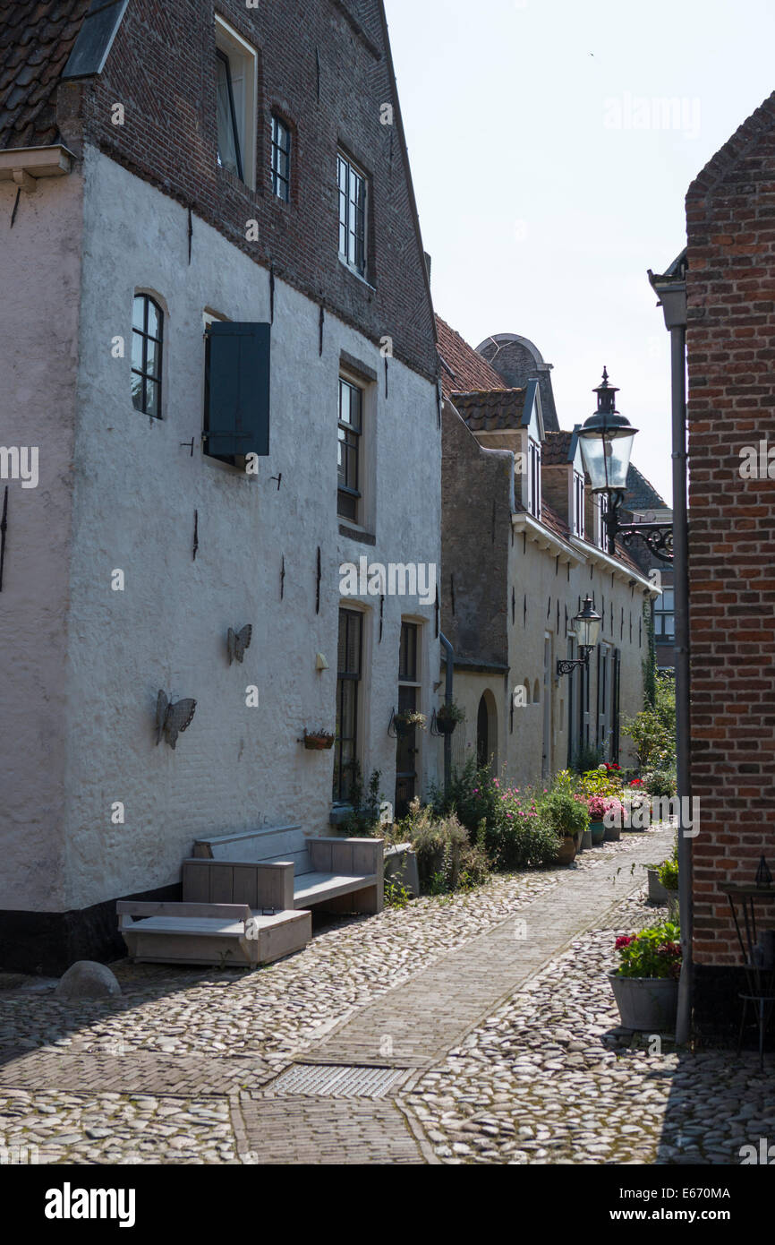 Romantic street in the old historical Hanseatic city 'Elburg' in the Netherlands - Stock Image